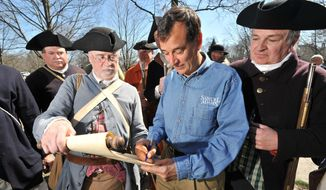 **FILE** Samuel Adams Founder and Brewer, Jim Koch, joins the Lexington Minute Men, a group of Revolutionary War re-enactors, in signing a new petition calling for Americans to honor Patriots' Day as a national holiday.  (PRNewsFoto/Samuel Adams, Josh Reynolds/AP Images)