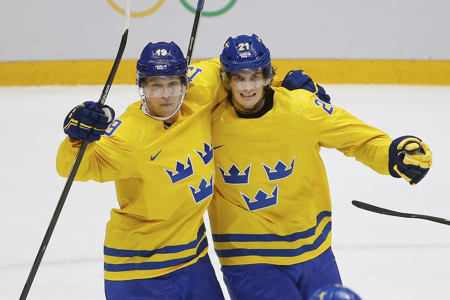Sweden forward Loui Eriksson, right, celebrates his goal against Finland with teammate Nicklas Backstrom during the second period of the men's semifinal ice hockey game at the 2014 Winter Olympics, Friday, Feb. 21, 2014, in Sochi, Russia. (AP Photo/Matt Slocum)