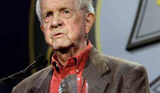 FILE - In this Feb. 18, 2009 file photo, Associated Press Hollywood correspondent Bob Thomas receives a special award of merit in Beverly Hills, Calif. Thomas died of age-related illnesses Friday, March 14, 2014 at his Encino, Calif., home, his daughter Janet Thomas said. He was 92.  (AP Photo/Nick Ut, File)