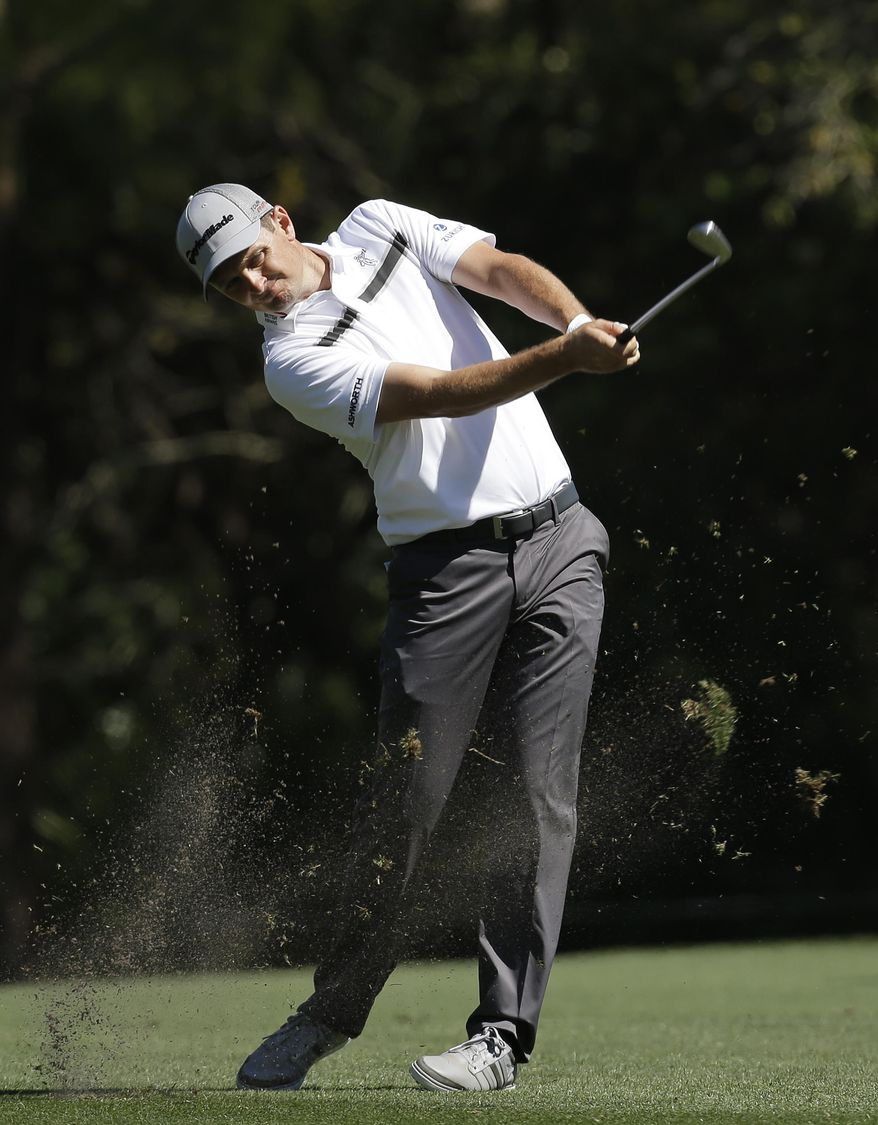 Justin Rose, of England, takes a divot as he hits from the seventh fairway during the second round of the Valspar Championship golf tournament at Innisbrook Friday, March 14, 2014, in Palm Harbor, Fla. (AP Photo/Chris O'Meara)