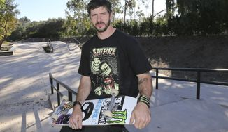 In this photo taken on Jan. 22, 2014, skateboarder Chris Cole sits on a railing at the top of one his backyard skateboard park at his home in San Marcos, Calif. Cole won the Street League Skateboarding Championship last year and DC Shoes just released the latest shoe in the Chris Cole line. (AP Photo/Lenny Ignelzi)