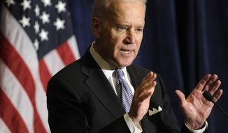 FILE - In this Feb. 27, 2014, file photo, Vice President Biden speaks at the Association of State Democratic Chairs Meeting in Washington. The White House says Biden will travel on Monday, March 17, to Poland and Lithuania amid tensions in nearby Ukraine. The trip is part of a U.S. effort to pressure Russia over a military intervention in Crimea that has the entire region on edge. (AP Photo/Susan Walsh, File)