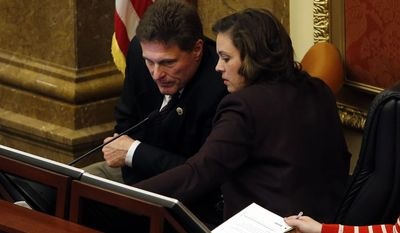 Rep. Jim Dunnigan, R-Taylorsville and House Speaker Becky Lockhart, R-Provo talks before he becomes Speaker pro tem at the Capitol in Salt Lake City, Thursday, March 13, 2014. (AP Photo/The Deseret News, Ravell Call)