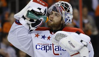 Washington Capitals' Braden Holtby during an NHL hockey game against the Philadelphia Flyers, Wednesday, March 5, 2014, in Philadelphia. (AP Photo/Matt Slocum)