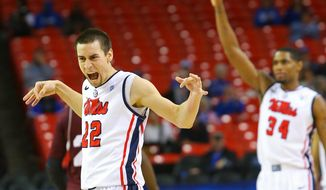Mississippi guard Marshall Henderson, left, and forward Aaron Jones react during the team's comeback against Mississippi State 78-66 in an NCAA college basketball game in the Southeastern Conference men's tournament, Thursday, March 13, 2014, in Atlanta.  (AP Photo/Atlanta Journal Constitution, Curtis Compton) GWINNETT OUT  MARIETTA OUT  LOCAL TV OUT (WXIA, WGCL, FOX 5)