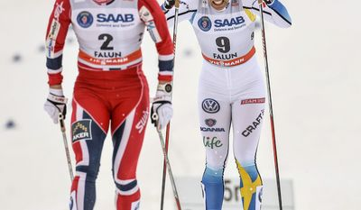 Norway's Marit Bjoergen, left, first place and Charlotte Kalla of Sweden second place after the quarter final Woman's FIS Cross-Country World Cup 1,2 km Sprint Classic in Falun,Sweden, Friday March 14, 2014. (AP Photo/TT, Anders Wiklund)   SWEDEN OUT