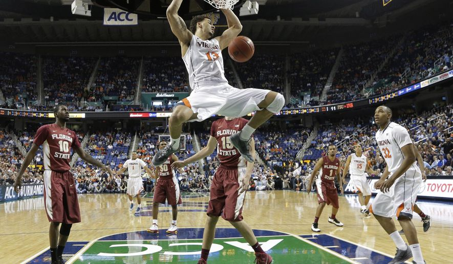 Virginia's Anthony Gill (13) dunks against Florida State during the first half of a quarterfinal NCAA college basketball game at the Atlantic Coast Conference tournament in Greensboro, N.C., Friday, March 14, 2014. (AP Photo/Gerry Broome)
