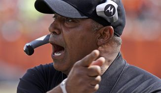 FILE - In this Sept. 25, 2011, file photo, Cincinnati Bengals head coach Marvin Lewis urges on his players during the first half of an NFL football game against the San Francisco 49ers in Cincinnati. Lewis signed a one-year contract extension Friday, March 14, 2014, keeping him on the job through the 2015 season. (AP Photo/Tom Uhlman, File)