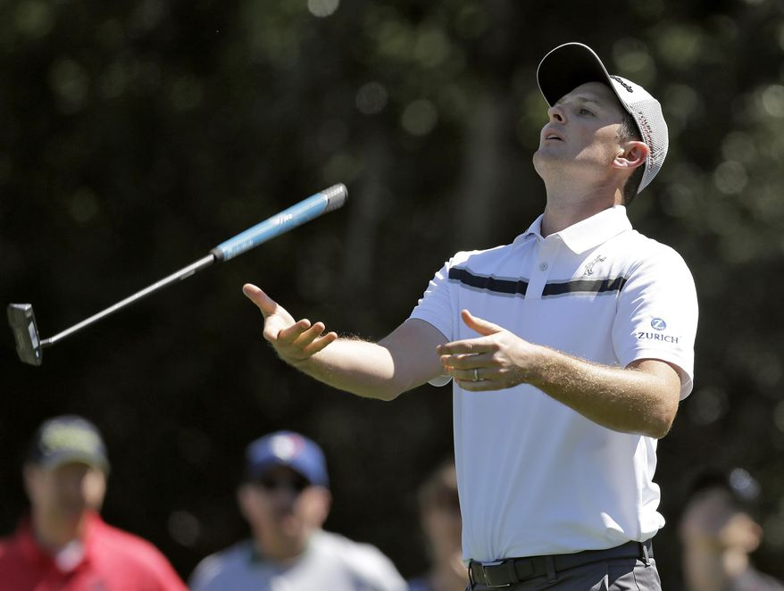Justin Rose, of England, tosses his club after missing a putt on the seventh green during the second round of the Valspar Championship golf tournament at Innisbrook Friday, March 14, 2014, in Palm Harbor, Fla. (AP Photo/Chris O'Meara)
