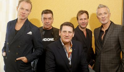 Spandau Ballet members, from left, Gary Kemp, John Keeble, Tony Hadley, Steve Norman and Martin Kemp pose for a photograph during the SXSW Music Festival on Thursday, March 13, 2014, in Austin, Texas. (Photo by Jack Plunkett/Invision/AP)