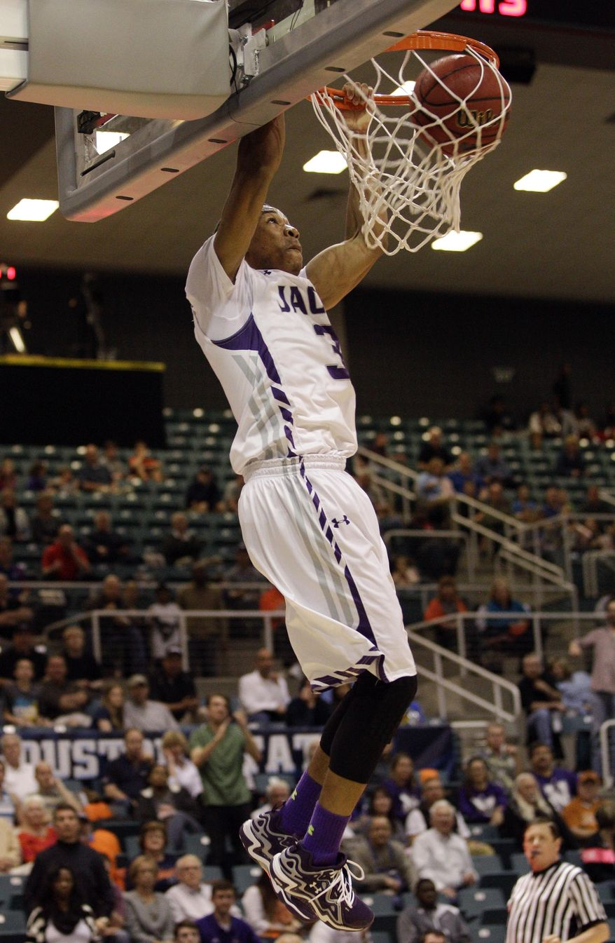 Stephen F. Austin Deshaunt Walker (3) slam dunks during the second half of an NCAA college basketball game in the semifinal round of the Southland Conference tournament Friday, March 14, 2014, in Katy. (AP Photo/Bob Levey)