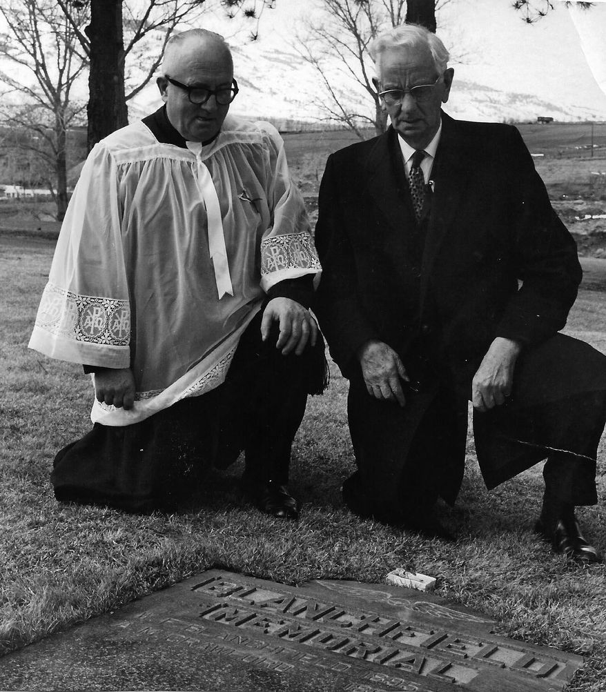 This March 17, 1969 file photo, the Rev. John O'Connor and Silas E. Ross place a sprig of shamrock sent from Ireland at the grave marker of William Blanchfield on St. Patrick's Day at the Mountain View Cemetery in Reno, Nev.  William Blanchfield is being remembered on two continents. In County Cork in Ireland, a float in Monday, March 17, 2014, St. Patrick's Day Parade will pay tribute Blanchfield, an Irish native and decorated Royal Air Force pilot in World War I. And on Sunday in Reno, the Sons and Daughters of Erin, an Irish heritage group, will continue the tradition of placing a shamrock sent from Ireland on Blanchfield's grave in Mountain View Cemetery.  (AP Photo/The Reno Gazette-Journal)