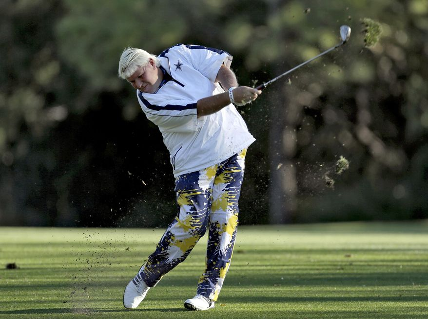 John Daly takes a divot as he hits from the seventh fairway during the second round of the Valspar Championship golf tournament at Innisbrook Friday, March 14, 2014, in Palm Harbor, Fla. (AP Photo/Chris O'Meara)