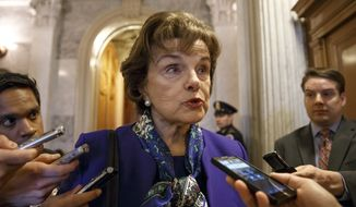 In this March 11, 2014, photo, Senate Intelligence Committee Chair Sen. Dianne Feinstein, D-Calif. talks to reporters as she leaves the Senate chamber on Capitol Hill in Washington, Tuesday, March 11, 2014, after saying that the CIA's improper search of a stand-alone computer network established for Congress has been referred to the Justice Department. For President Barack Obama, a public spat between his trusted ally at the CIA and a loyal Democratic senator has put into sharp focus his complicated role in managing the post-Sept. 11 anti-terror programs he inherited from George W. Bush. (AP Photo/J. Scott Applewhite)