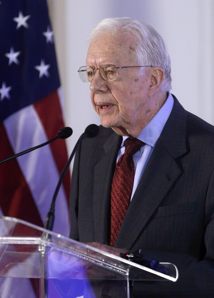 Former U.S. President Jimmy Carter speaks at an Ethical Elections Pact signing ceremony in Panama City, Friday, March 14, 2014. Panama will hold a general election on May 4 in which Panamanians will elect a new president. The pact was signed by the seven competing presidential candidates. (AP Photo/Arnulfo Franco)