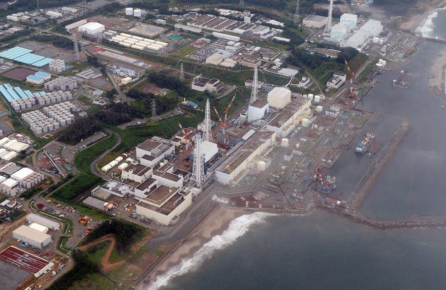 ** FILE ** This Aug. 20, 2013 file photo shows the Fukushima Dai-Ichi nuclear plant at Okuma in Fukushima prefecture, northern Japan. (AP Photo/Kyodo News)