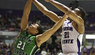 North Dakota's Quinton Hooker (21) and Weber State's Joel Bolomboy (21) battle for a rebound during the first half of an NCAA college basketball game in the championship of the Big Sky Conference tournament Saturday, March 15, 2014, in Ogden, Utah. (AP Photo/Rick Bowmer)