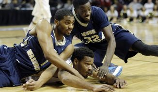George Washington's Maurice Creek, left, teammate Isaiah Armwood, right, and VCU's Jordan Burgess look after a loose ball during the first half of an NCAA college basketball game in the semifinal round of the Atlantic 10 Conference tournament at the Barclays Center in New York, Saturday, March 15, 2014. (AP Photo/Seth Wenig)