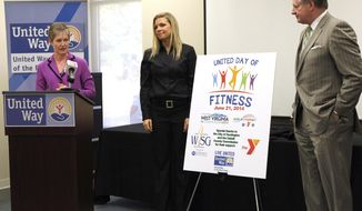 ADVANCE FOR USE SATURDAY, MARCH 15, 2014, AND THEREAFTER - In this Monday, March 10, 2014 photo, United Way of the River Cities Executive Director Laura Gilliam, left, Cabell County Commissioner Anne Yon and Mayor Steve Williams, right,  announce United Day of Fitness during a news conference in Huntington, W.Va.  (AP Photo/The Herald-Dispatch, Lori Wolfe)