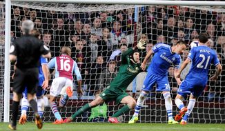 Aston Villa's  Fabian Delph, second left, scores against Chelsea during the English Premier League soccer match between Aston Villa and Chelsea at Villa Park, Birmingham, England, Saturday, March 15, 2014.  (AP Photo/Rui Vieira)