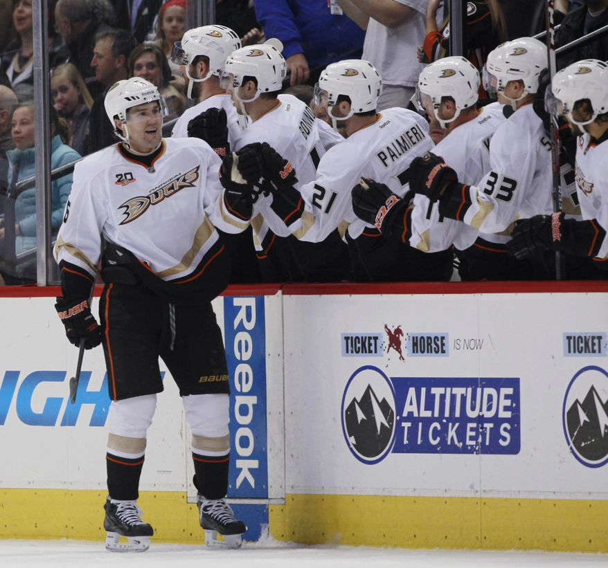 Anaheim Ducks defenseman Ben Lovejoy, far left, is congratulated after his goal by teammates while facing the Colorado Avalanche in the second period of an NHL hockey game in Denver on Friday, March 14, 2014. (AP Photo/David Zalubowski)