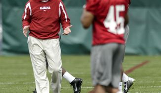 Alabama head coach Nick Saban works with the defensive backs during spring NCAA college football practice, Saturday, March 15, 2014, at the Thomas-Drew Practice Facility in Tuscaloosa, Ala. (AP Photo/Alabama Media Group, Vasha Hunt) MAGS OUT