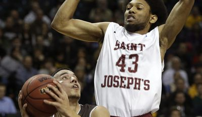 St. Bonaventure's Matthew Wright, left, looks for a shot past Saint Joseph's DeAndre Bembry during the first half of an NCAA college basketball game in the semifinal round of the Atlantic 10 Conference tournament at the Barclays Center in New York, Saturday, March 15, 2014. (AP Photo/Seth Wenig)
