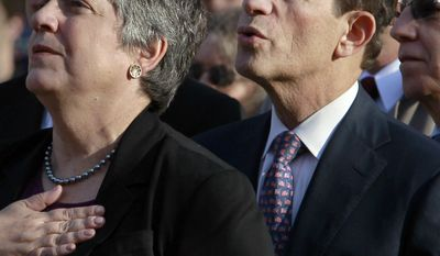U.S. Homeland Security Secretary Janet  Napolitano, center, and Massachusetts Treasurer Steven Grossman, right, place their hands on their chests during the playing of the national anthem at a ceremony held to add three new names to Northeastern University's Veterans Memorial, in Boston. Grossman, a first-term state treasurer and onetime head of the Democratic National Committee, is running for governor in 2014. (AP Photo/Steven Senne)