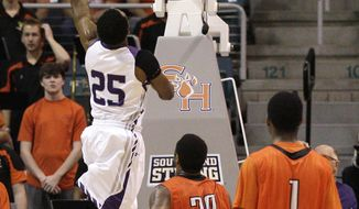 Stephen F. Austin's Desmond Haymon (25) drives to the basket for a layup during the first half of an NCAA college basketball game in the championship of the Southland Conference tournament Saturday, March 15, 2014, in Katy, Texas. (AP Photo/Bob Levey)