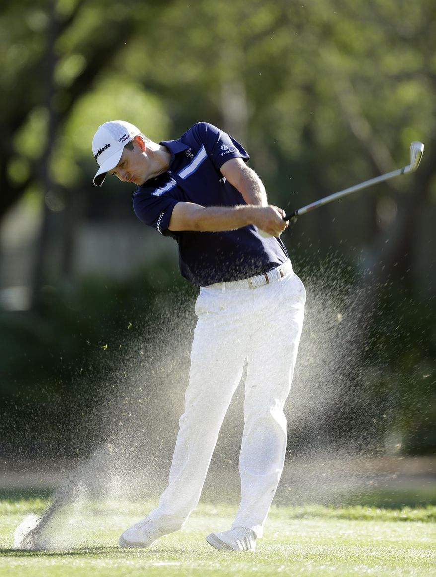 Justin Rose, of England, hits his tee shot on the 17th hole during the third round of the Valspar Championship golf tournament at Innisbrook Saturday, March 15, 2014, in Palm Harbor, Fla. (AP Photo/Chris O'Meara)