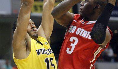 Ohio State guard Shannon Scott (3) goes up for a shot against Michigan forward Jon Horford (15) in the first half of an NCAA college basketball game in the semifinals of the Big Ten Conference tournament Saturday, March 15, 2014, in Indianapolis. (AP Photo/Kiichiro Sato)