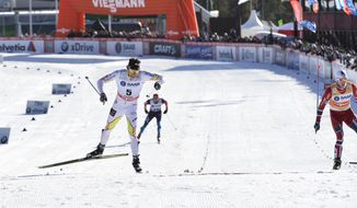 Canada's Alex Harvey, left, jubilates after winning the men's FIS World Cup cross country skiathlon race in Falun, Sweden, Saturday, March 15, 2014. (AP photo/ TT, Anders Wiklund)  SWEDEN OUT