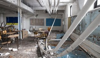 A classroom at the closed Southwestern High School in Detroit has had its pipes torn down and its blackboards ripped off the walls and left on the floor, Feb. 18, 2014. Five years after Michigan targeted copper thefts plaguing cities like Detroit and disrupting railroads and utilities, plans to better restrict sales of stolen scrap metal are caught in a legislative fight despite agreement among political leaders and law enforcement that action is needed. The legislation would tighten rules in what can be a lucrative scrap metal market, giving police and prosecutors more tools to bolster cases against thieves. Scrapyards would have to take photos or video of metal they buy. Sellers could only be paid by check or money order, or they could redeem their money at an onsite ATM that takes photos of them getting the cash. (AP Photo/The Grand Rapids Press, Katie Bailey) ALL LOCAL TV OUT; LOCAL TV INTERNET OUT