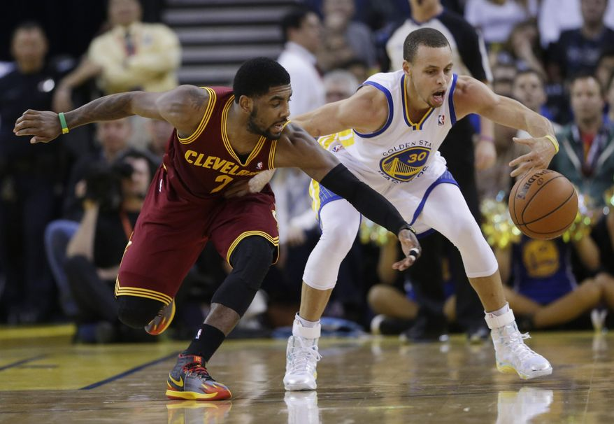 Cleveland Cavaliers guard Kyrie Irving, left, battles for a loose ball against Golden State Warriors guard Stephen Curry during the first half of an NBA basketball game on Friday, March 14, 2014, in Oakland, Calif. (AP Photo/Marcio Jose Sanchez)