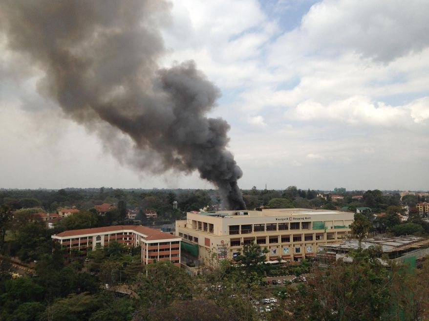 FILE - In this Monday, Sept. 23, 2013 file photo, heavy black smoke rises from the Westgate Mall in Nairobi, Kenya after multiple large blasts rocked the mall during an assault by security forces after gunmen threw grenades and opened fire during an attack that left multiple dead and dozens wounded. Kenya's lead counterterrorism agency is working to stop another Westgate Mall-style terrorist attack that many here believe Somali militants will try again, but the anti-terror unit is struggling to do its work because of limited funds, according to a security official from the police headquarters. (AP Photo/Jerome Delay, File)