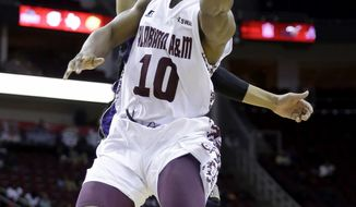 Alabama A&M's Jeremy Crutcher (10) goes up for a shot as Prairie View A&M's Louis Munks defends during the first half of an NCCA college basketball game in the semifinals of the Southwestern Athletic Conference tournament Friday, March 14, 2014, in Houston.