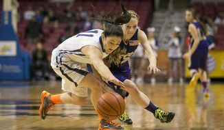CORRECTS NAME TO GRIFFIN DEMPSEY, NOT DEMPSEY GRIFFIN - St. Joseph's Griffin Dempsey (11) and St. Marys' Jenna Nichols (12) go after a loose ball during the class A girls' state championship basketball game Saturday, March 15, 2014 in Charleston, W.Va. (AP Photo/Michael Switzer)