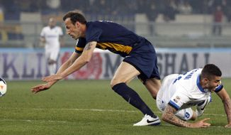 Inter Milan's Mauro Icardi, right, is fouled by Hellas Verona Greek defender Evangelos Moras during a Serie A soccer match at the Bentegodi stadium in Verona, Italy, Saturday, March 15, 2014. (AP Photo/Felice Calabro')