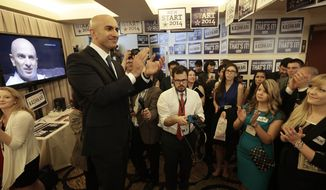 Gubernatorial candidate Neel Kashkari speaks with his campaign workers at the California Republican Party 2014 Spring Convention Saturday, March 14, 2014, in Burlingame, Calif. (AP Photo/Ben Margot)