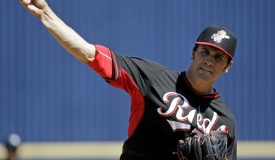 Cincinnati Reds' Brett Marshall throws before the first inning of an exhibition spring baseball game against the Milwaukee Brewers, Saturday, March 15, 2014, in Phoenix. (AP Photo/Morry Gash)