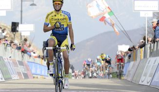 Spain's Alberto Contador celebrates as he wins the fourth stage of the Tirreno Adriatico cycling race, in Selvarotonda, Italy, Saturday, March 15, 2014. (AP Photo/Fabio Ferrari, Lapresse) ITALY OUT
