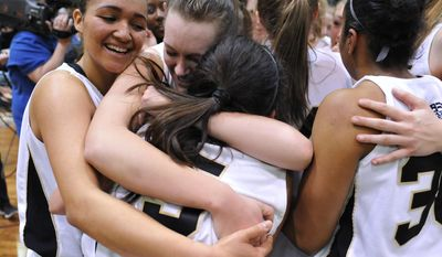 Army's Brianna Johnson, Jen Hazlett and Kelsey Minato embrace after beating Holy Cross in an NCAA college basketball game in the Patriot League Championship at Christi Arena, Saturday, March 15, 2014, at West Point, N.Y. Army won 68-58. (AP Photo/Karl Rabe)