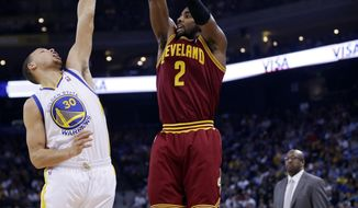 Cleveland Cavaliers guard Kyrie Irving (2) shoots over Golden State Warriors guard Stephen Curry (30) during the first half of an NBA basketball game on Friday, March 14, 2014, in Oakland, Calif. (AP Photo/Marcio Jose Sanchez)