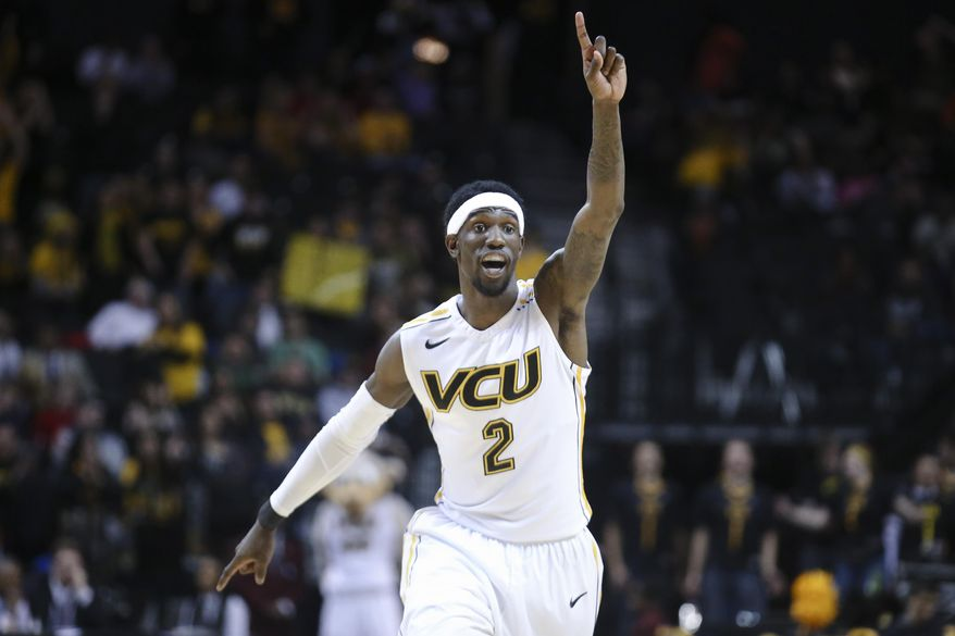 VCU guard Briante Weber (2) reacts during the first half of an NCAA college basketball game against Richmond in the quarterfinal round of the Atlantic 10 Conference tournament at the Barclays Center in New York, Friday, March 14, 2014. VCU defeated Richmond, 71-53. (AP Photo/John Minchillo)
