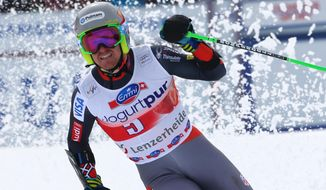 Ted Ligety, of the United States, celebrates at the finish area after winning an Alpine Ski men's giant slalom at the World Cup finals, in Lenzerheide, Switzerland, Saturday, March 13, 2013. (AP Photo/Armando Trovati)