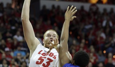 New Mexico's Alex Kirk shoots over Boise State's Ryan Watkins during the first half of an NCAA college basketball game in the semifinals of the Mountain West Conference tournament Friday, March 14, 2014, in Las Vegas. (AP Photo/Isaac Brekken)