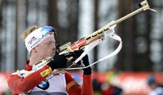 Norway's Johannes Thingnes Boe prepares to shoot before winning the men's 10 km sprint competition of the IBU World Cup Biathlon event in Kontiolahti, Eastern Finland, Saturday, March 15, 2014. (AP Photo/Lehtikuva, Heikki Saukkomaa)  FINLAND OUT