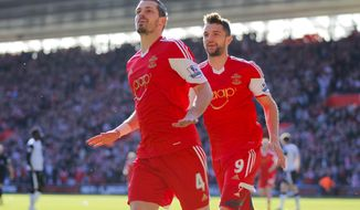 Southampton's Morgan Schneiderlin, left, celebrates his goal against Norwich City with teammate Jay Rodriquez during their English Premier League soccer match at St Marys, Southampton, England, Saturday, March 15, 2014. (AP Photo/Chris Ison, PA Wire)    UNITED KINGDOM OUT    -   NO SALES   -   NO ARCHIVES