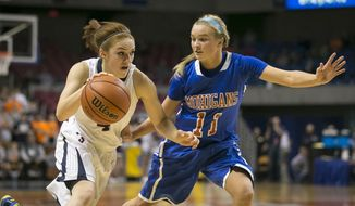 Parkersburg South's Taryn McCutcheon (4) drives past Morgantown's Olivia Seggie (11) during the AAA West Virginia girls' state championship game Saturday, March 15, 2014 in Charleston, WV. (AP Photo/Michael Switzer)