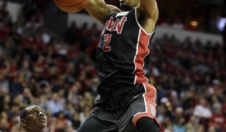 UNLV's Khem Birch dunks during the first half of an NCAA college basketball game against San Diego State in the semifinals of the Mountain West Conference tournament Friday, March 14, 2014, in Las Vegas. (AP Photo/Isaac Brekken)